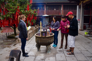MBA students burn incense at a temple in Zhujiajiao