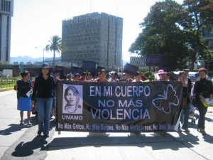 Mendez demonstrating with UNAMG on International Day for the Elimination of Violence Against Women, in 2006