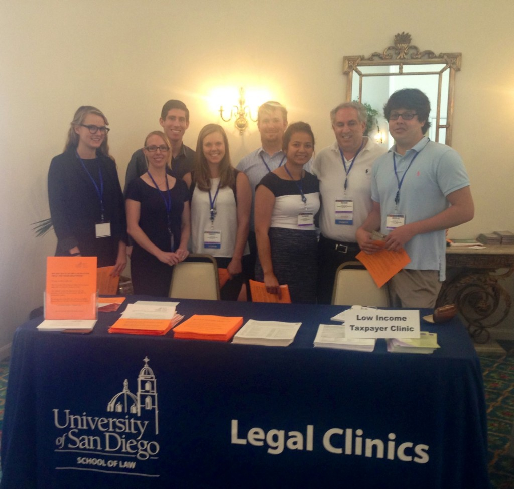 At the Legal Clinics' Resource Booth (left to right), legal interns Sarah Oyer, Ashley Cook, Ian Friedman, Kim Mulder, Ryan Cramer, Chandara Diep, Professor Richard Carpenter and Nick Choy.