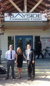 (Left to right) Eric Schwarberg, Danica Brustkern and Supervising Attorney Franco Simone in front of the Bayside Community Center.