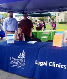 Federal Tax Clinic legal interns Todd Mora and Carl Jones and Small Claims Clinic legal intern Jennifer Avina at the USD Legal Clinics booth at the 2014 Lind Vista Multicultural Fair.