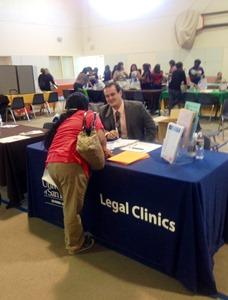 De la Torre answering questions regarding Legal Clinics' services.