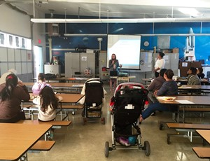 Federal Tax Clinic Law Clerk Natalie Rodriguez presenting to parents on IRS tax issues.