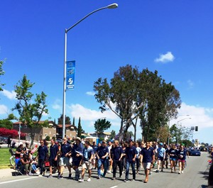 USD Spirit Team and Sports Teams participating in the parade.