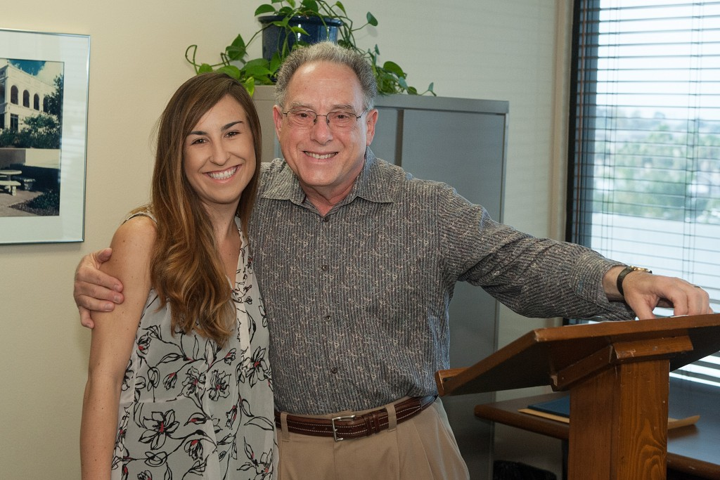 Legal intern Caitlin Macher receiving the Civil Clinic Award with Supervising Attorney Allen Gruber.