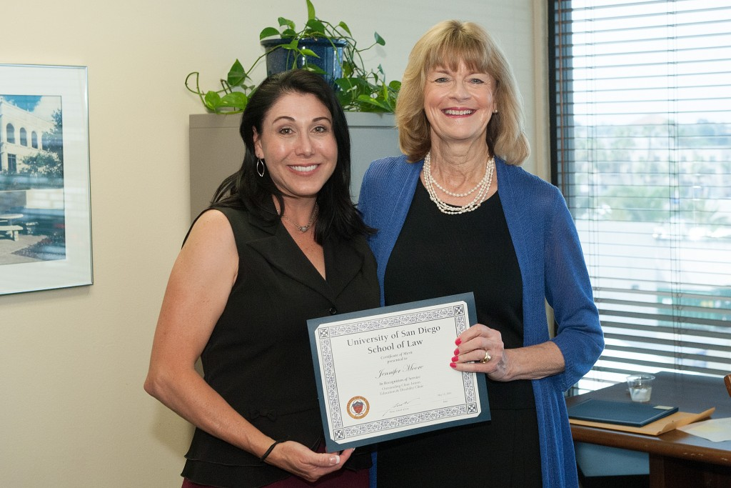 Legal intern Jennifer (J.J.) Moore receiving the Education & Disability Clinic Award with Supervising Attorney Margaret.