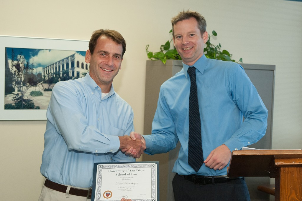 Legal intern David Romberger receiving the Federal Tax Award.  Eric Austin presented the award on behalf of Supervising Attorney Richard Carpenter.