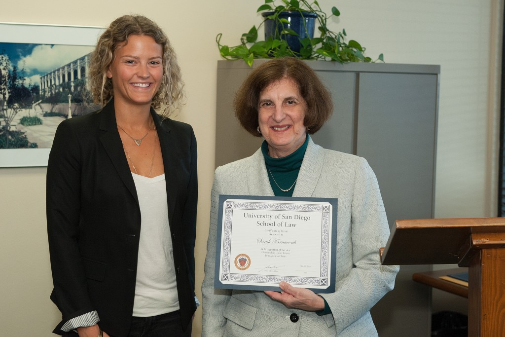 Legal intern Sarah Farnsworth receiving the Immigration Award with Supervising Attorney Sandra Wagner.