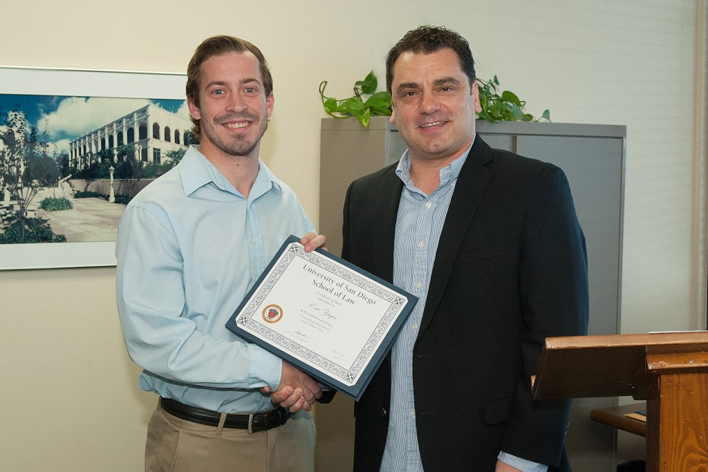 Legal intern Eric Zeiger receiving the Small Claims Award with Supervising Attorney Franco Simone.