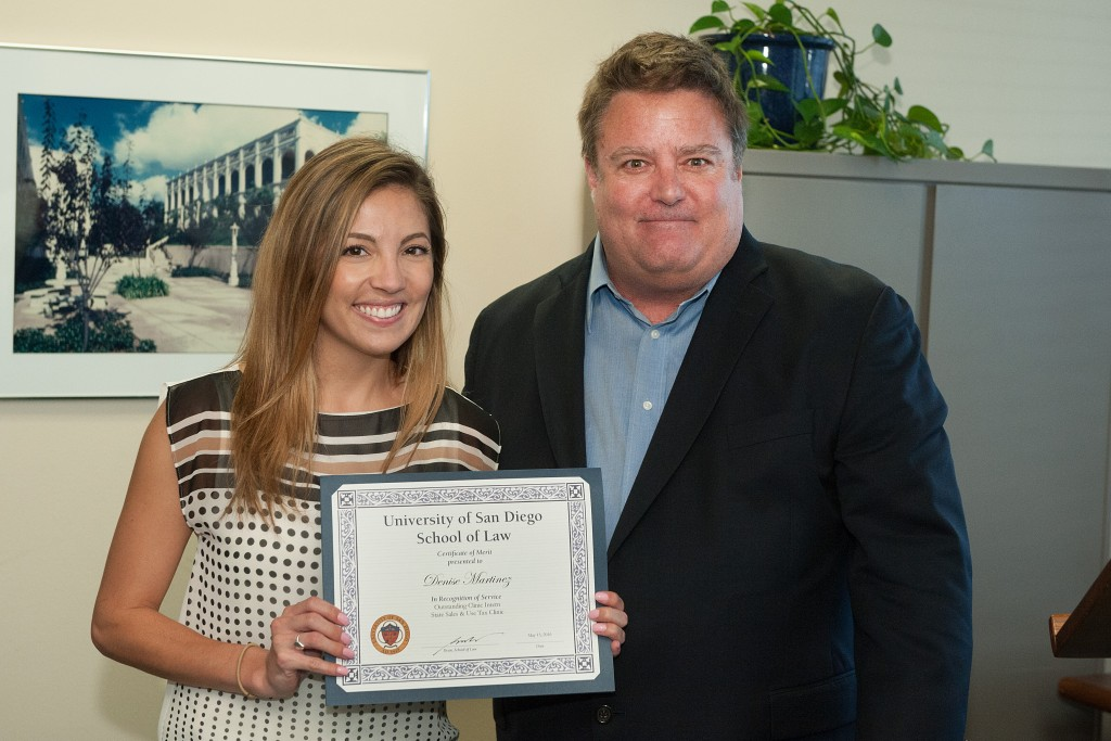 Legal intern Denise Martinez receiving the States Sales & Use Tax Clinic Award with Supervising Attorney Michael Larkin.