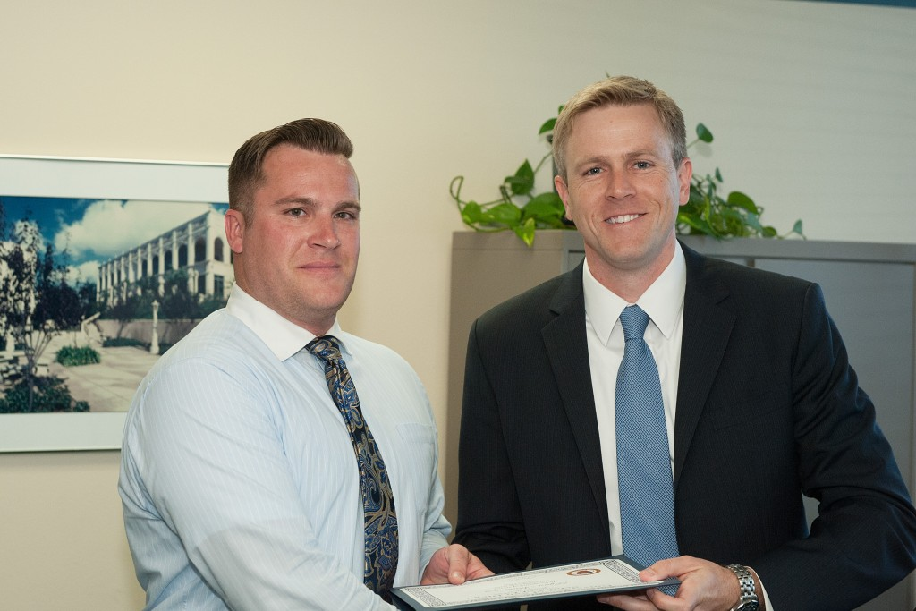 Legal intern Ryan Mackintosh receiving Veterans Clinic Award with Supervising Attorney Robert Muth.