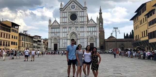 Photo of Rosa with other students standing in front of the Basilica di Santa Croce in Florence, Italy