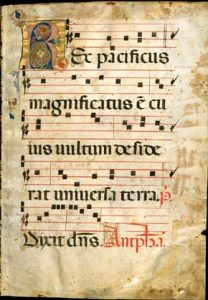 "Medieval sheet music with lyrics that read, ""Ex pacificus magnificatus e cu ws uulrum defide rat uniuerfa terra. Dixit dns. Antplaa."""