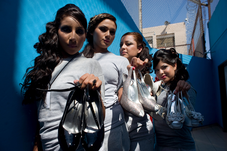 Female inmates at the Baja California state prison in Tijuana pose for a photograph with high heel shoes they will wear during the prison's first beauty pageant. Photo - David Maung, 2013