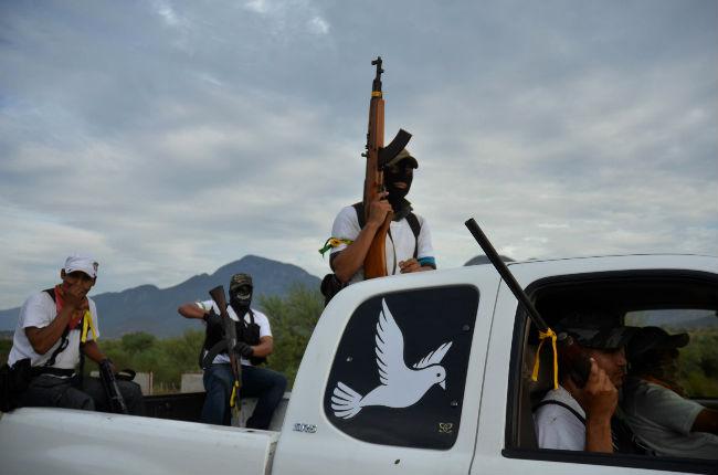 Self-defense forces patrol in La Ruana. Archival photo from Cuartoscuro.