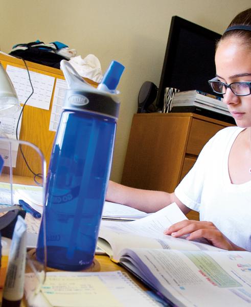 Student in dorm at desk