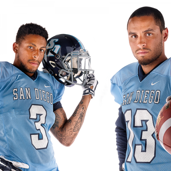 USD football receivers Brandon White and Reggie Bell.