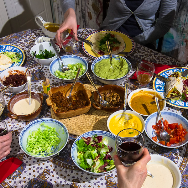 Diners gathered around a Mexican feast.