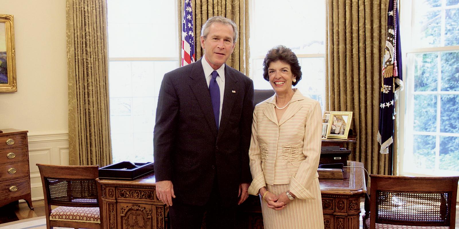 President George Bush alongside Marilyn Jacanin '63
