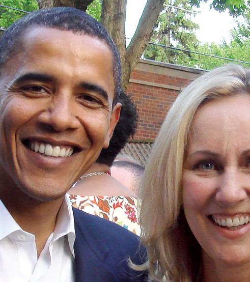 Barack Obama alongside Betsy Myers '82.