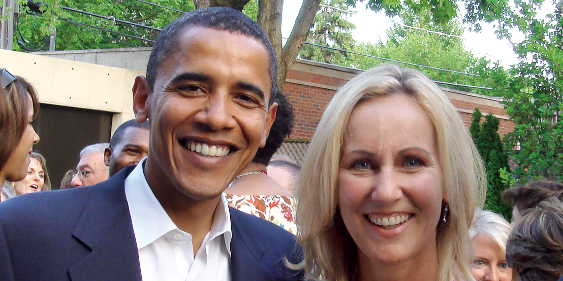 Barack Obama alongside Betsy Myers '82.
