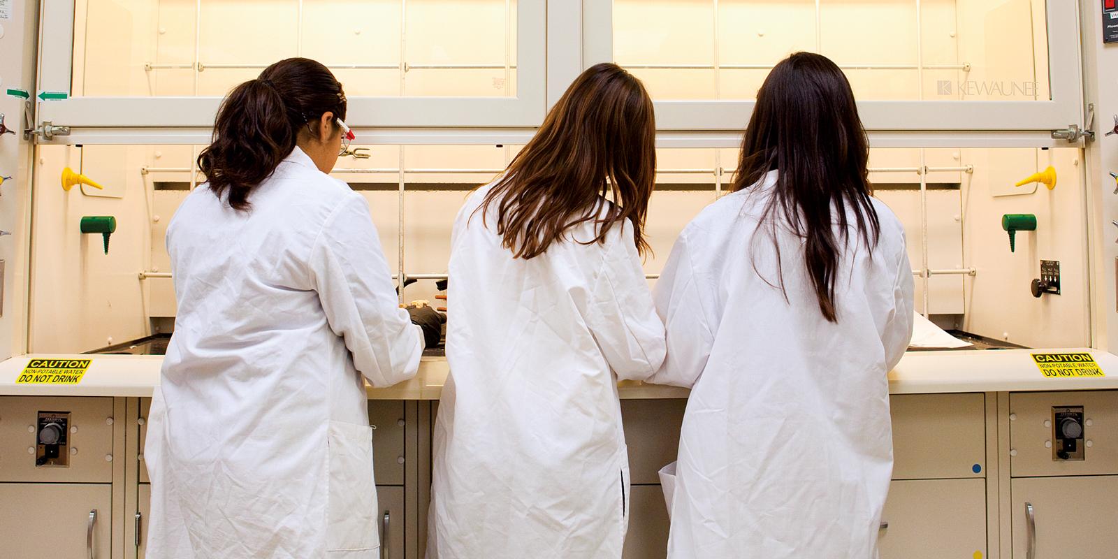Girls in science coats