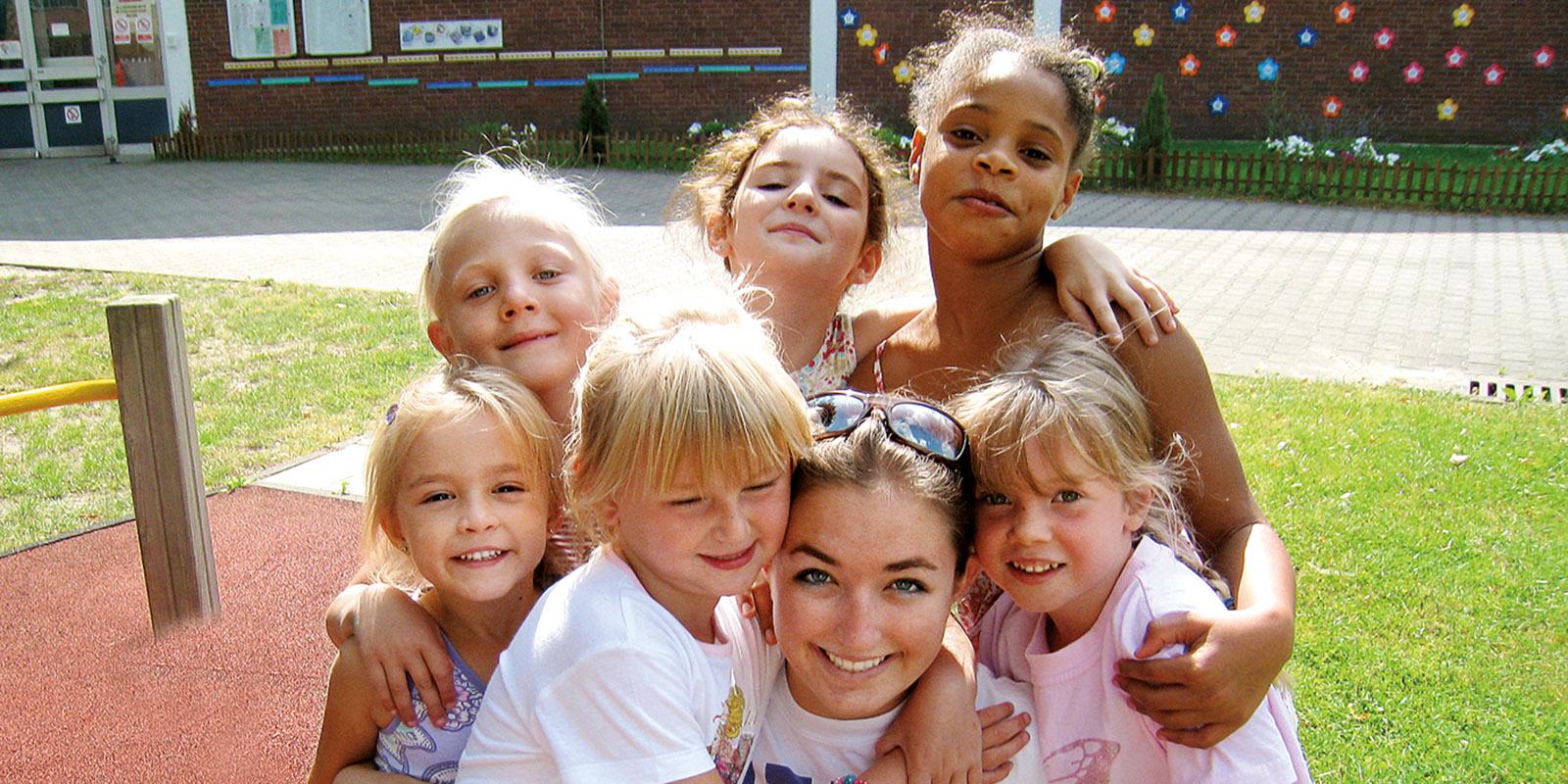 Children of soldiers surround Cally Evanhoff '12.