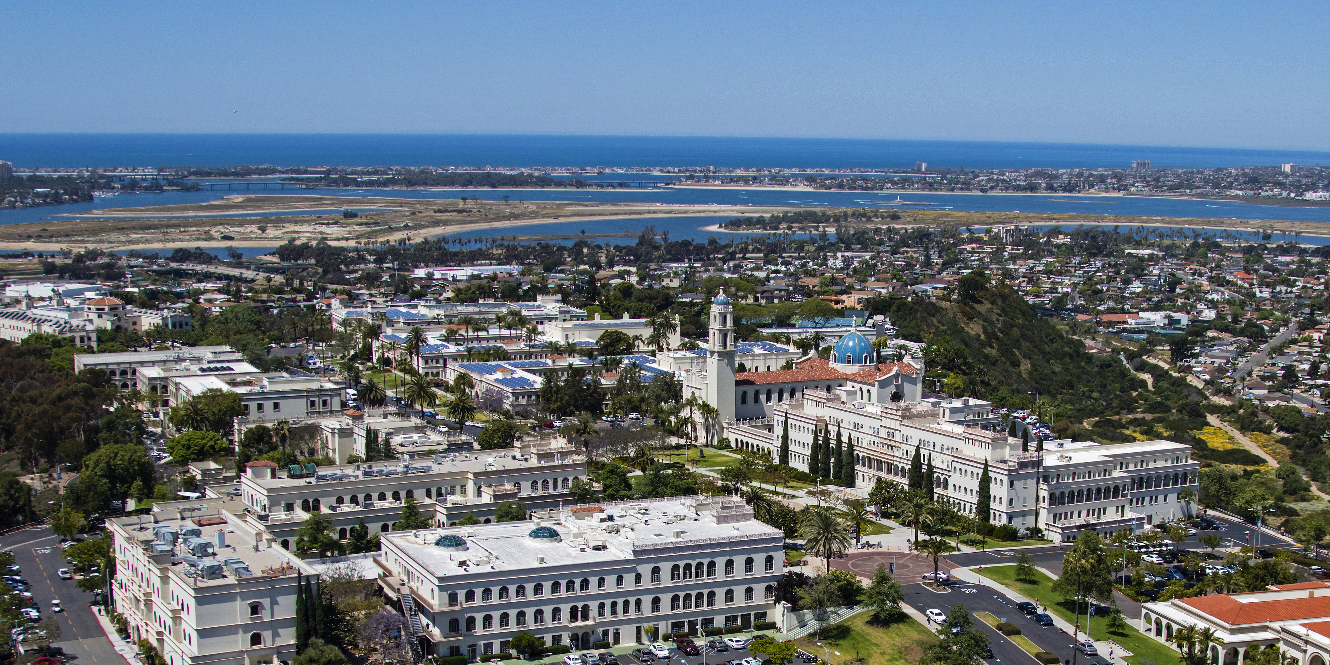 USD campus aerial shot showing the horizon and bay in the background.