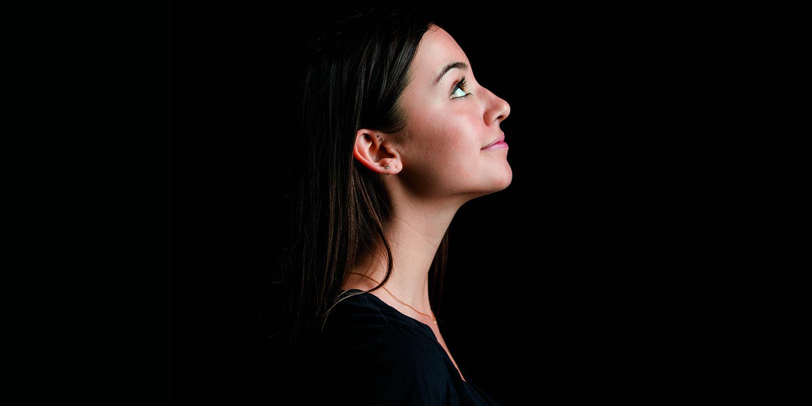 Erin Carollo looks up in profile