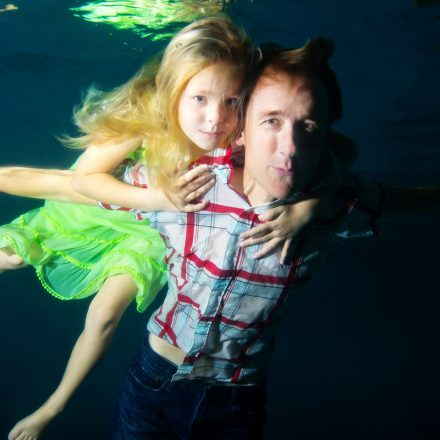 USD alumnus Steve Melen floats underwater alongside his daughter, Ava.