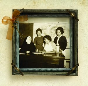 Archival photo of San Diego College for Women students with a Sister of the Sacred Heart
