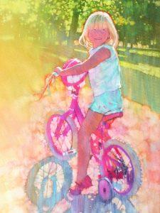 Young girl beams on bike.