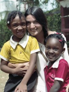 Maria Silva '12 on an immersion trip to Jamaica. She is now the Mulvaney Center's director of neighborhood and community engaged partnerships.