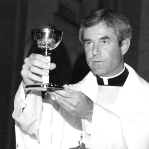 Father Larry Dolan celebrates Mass.