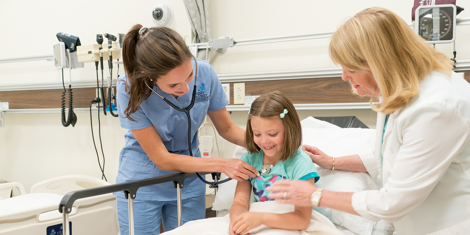 """Students and a child """"patient"""" at USD's Dickinson Simulation Center"""