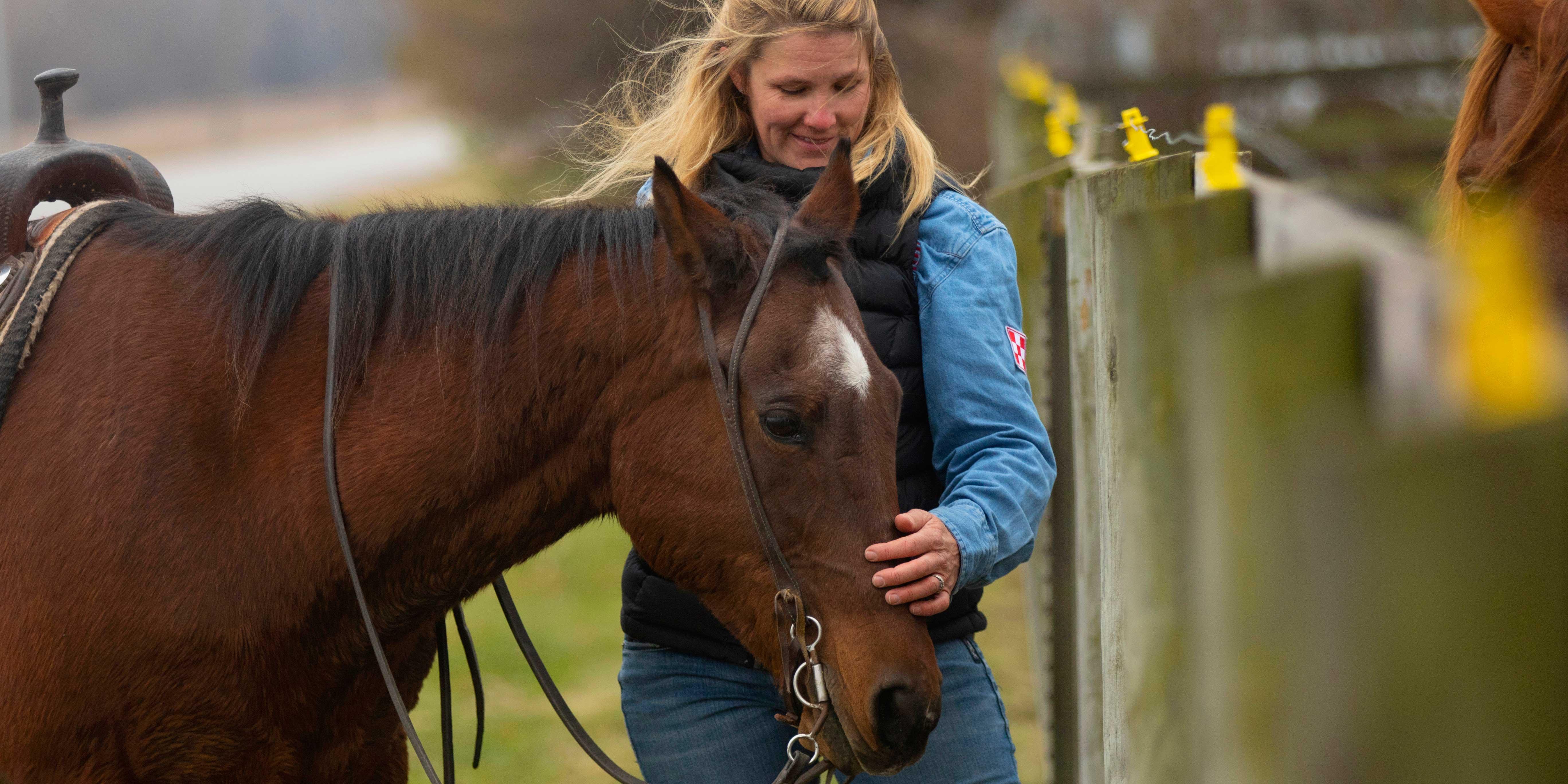 USD alumna Meggan Hill-McQueeny with horse
