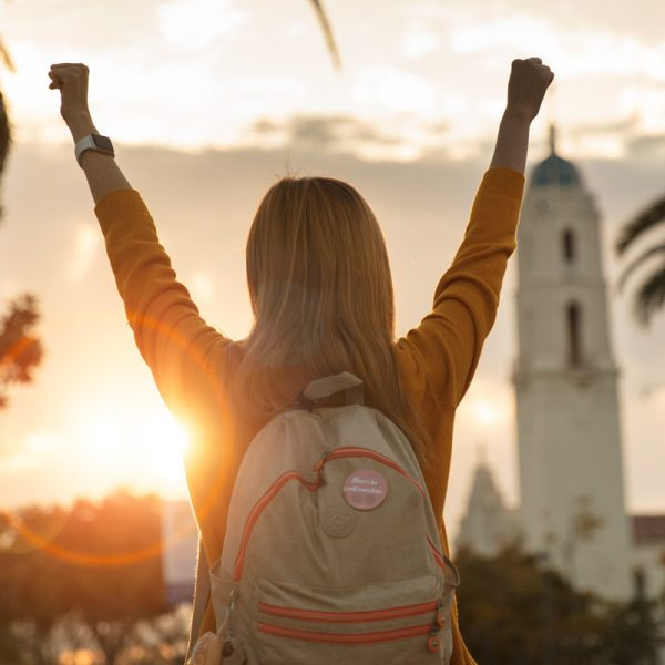 USD student raises arms in victory.