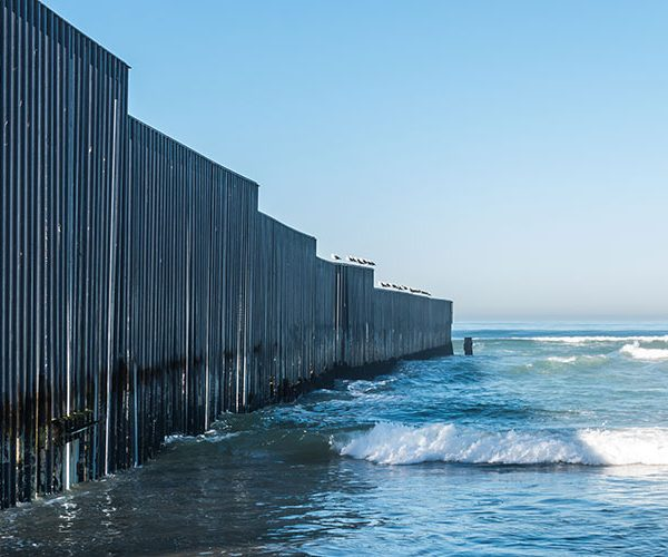 Wall between U.S. and Mexico with ocean