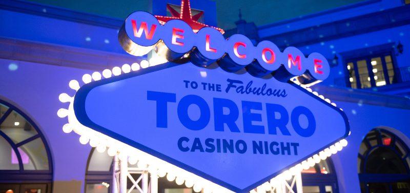 "Glizty Vegas-style sign reading ""Welcome to the Fabulous Torero Casino Night."