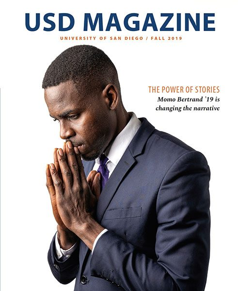 Cover image of the Fall 2019 issue of USD Magazine features Momo Bertrand '19 (MA), hands clasped as if in prayer.