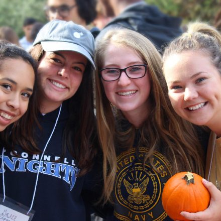 Four USD students smile while on a University Ministry-sponsored event.