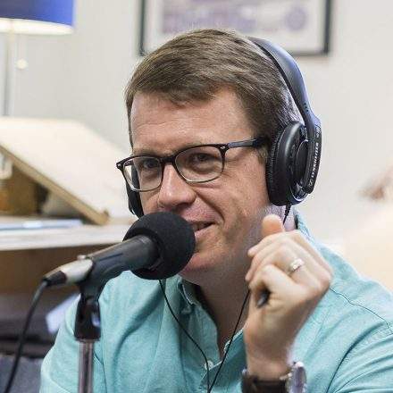 """USD political science professor Tim McCarty recording the podcast """"A Few Reasonable Words."""""""
