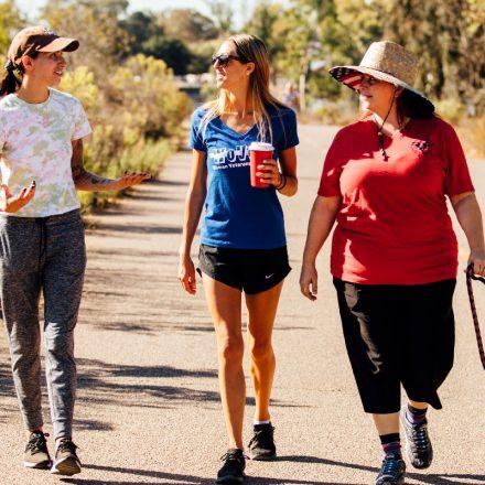 Three women veterans walk around Lake Murray.