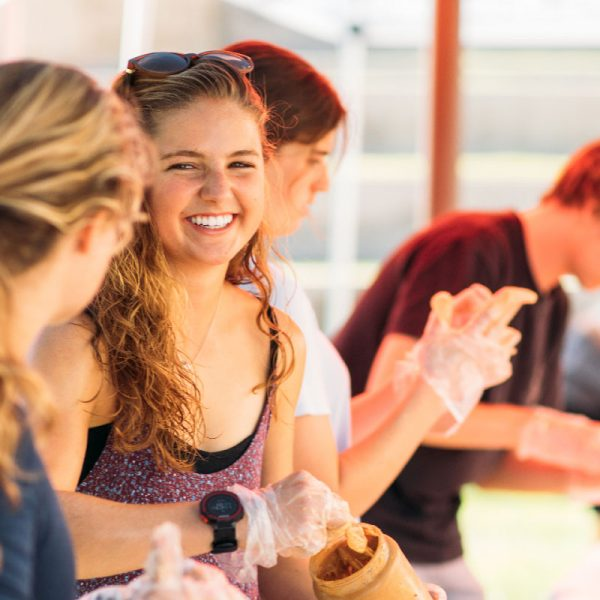 USD students gather together to make sandwiches for the homeless