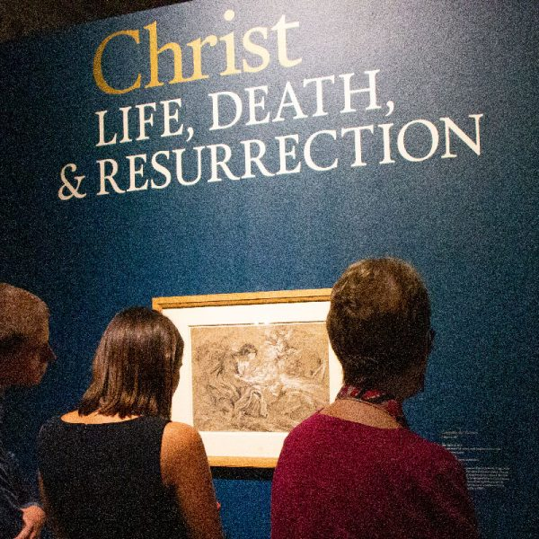 "Gallery visitors enjoying USD's ""Life of Christ"" art exhibit"