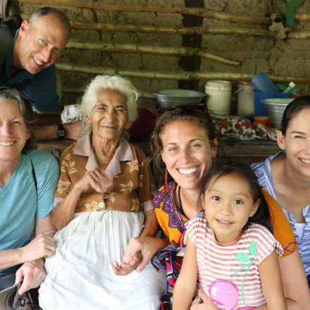 Ella Guimond '13 (BA) working alongside colleagues and community members in El Salvador, as part of her work with Catholic Relief Services.