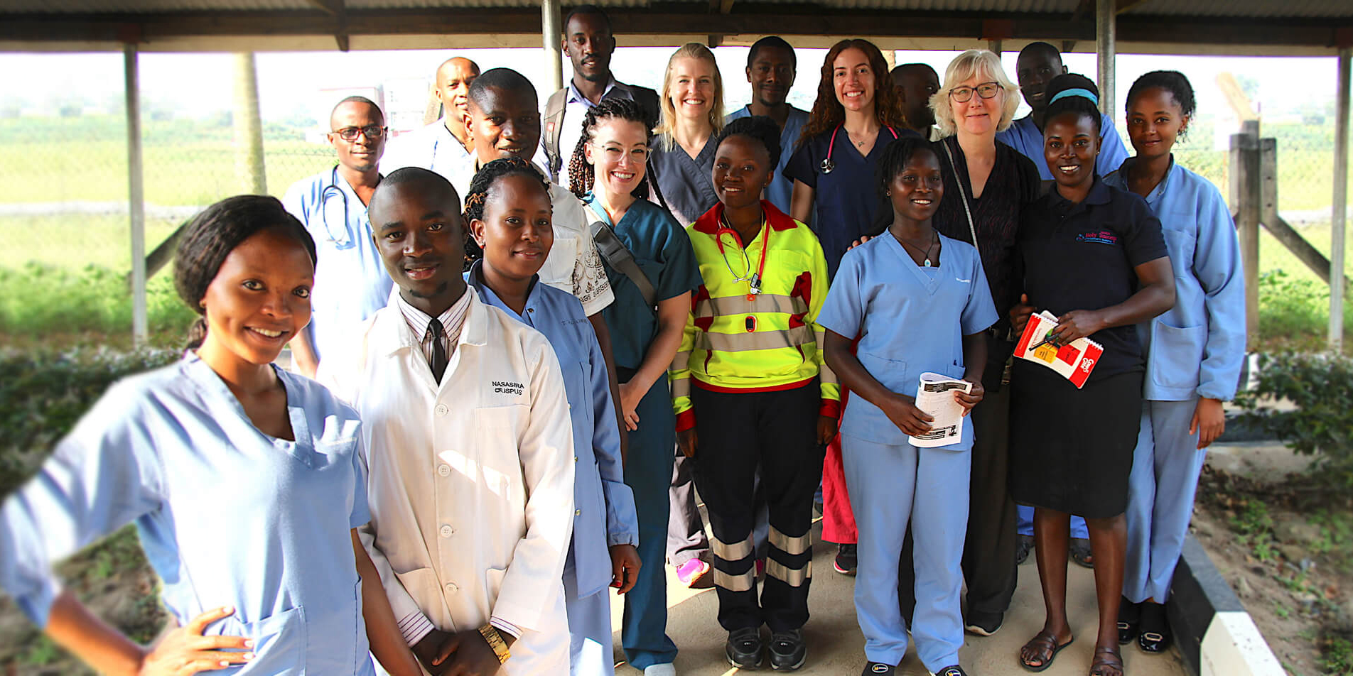 group of USD nurses with members of he community in Uganda.