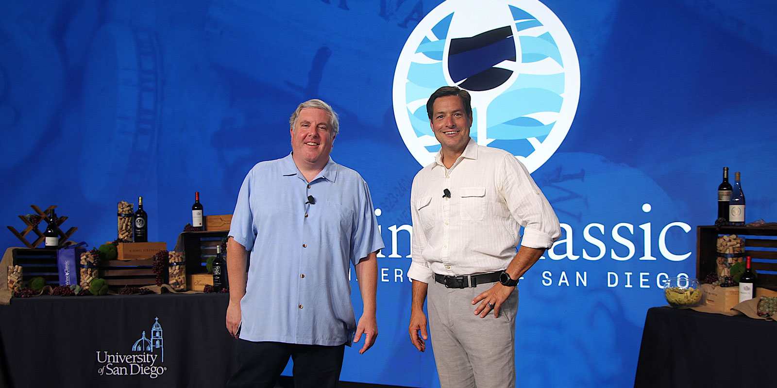 Senior Director of Alumni Relations (pictured at left, alongside Wine Classic co-host and auctioneer Clint Bell)