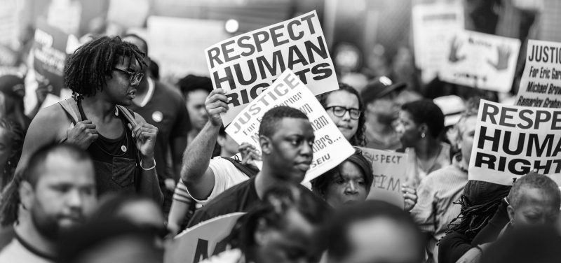 Black and white photo of protesters marching in support of Black lives.