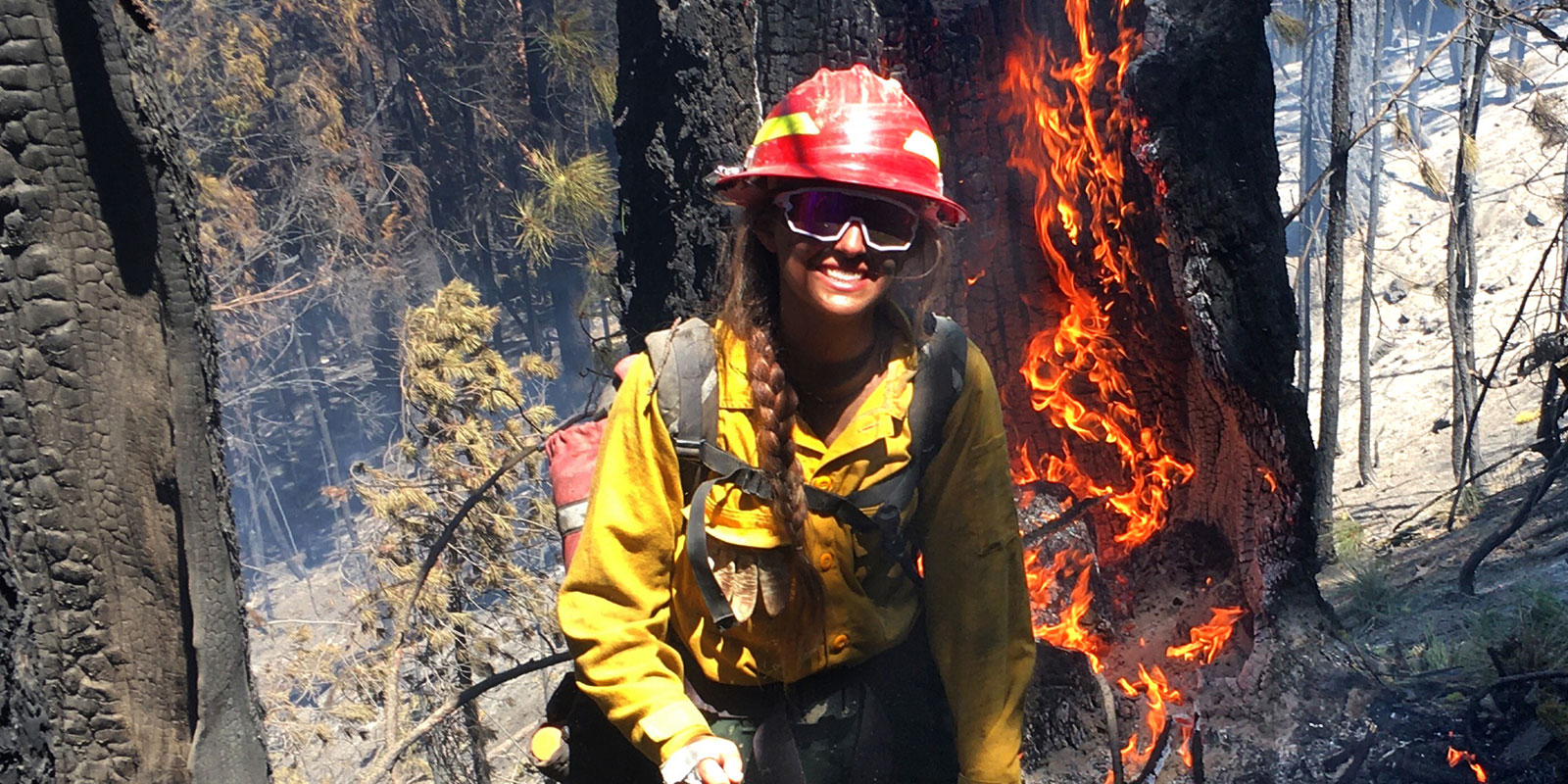 USD student Claire Graziano on site fighting a fire